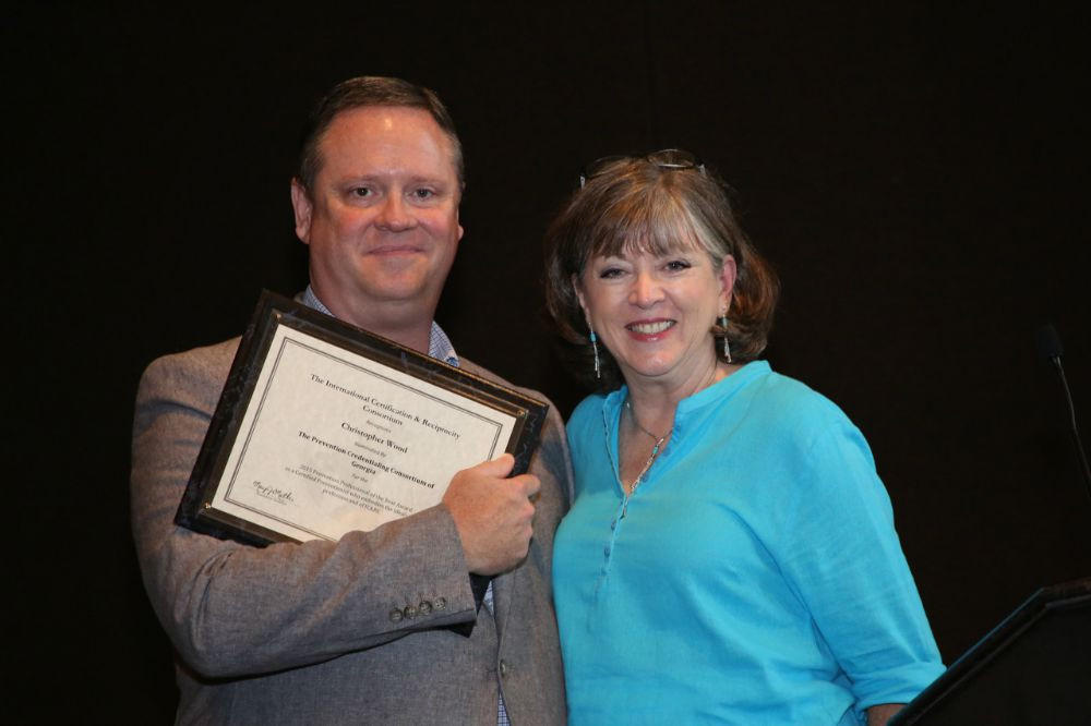 Chris Wood, winner of the 2015 Prevention Professional of the Year Award, with presenter Ari Russell.